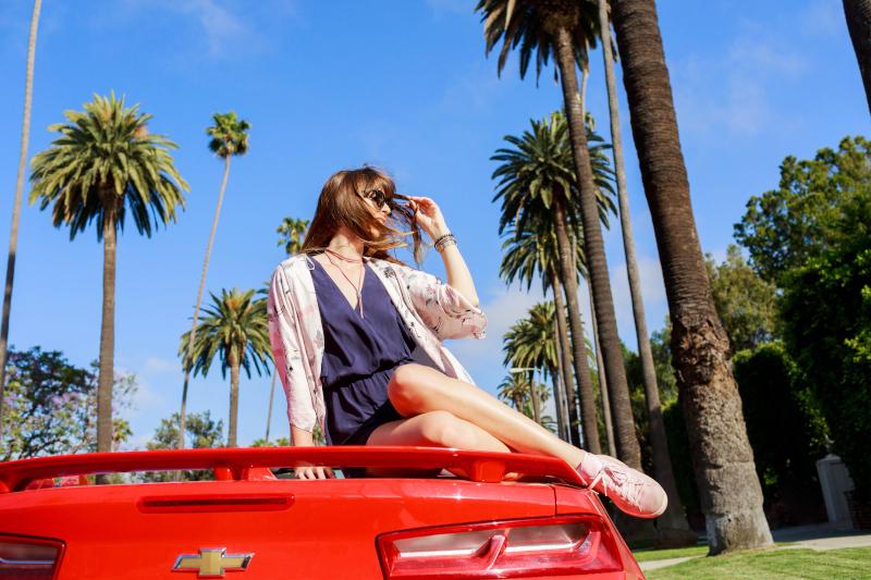 girl sitting on car
